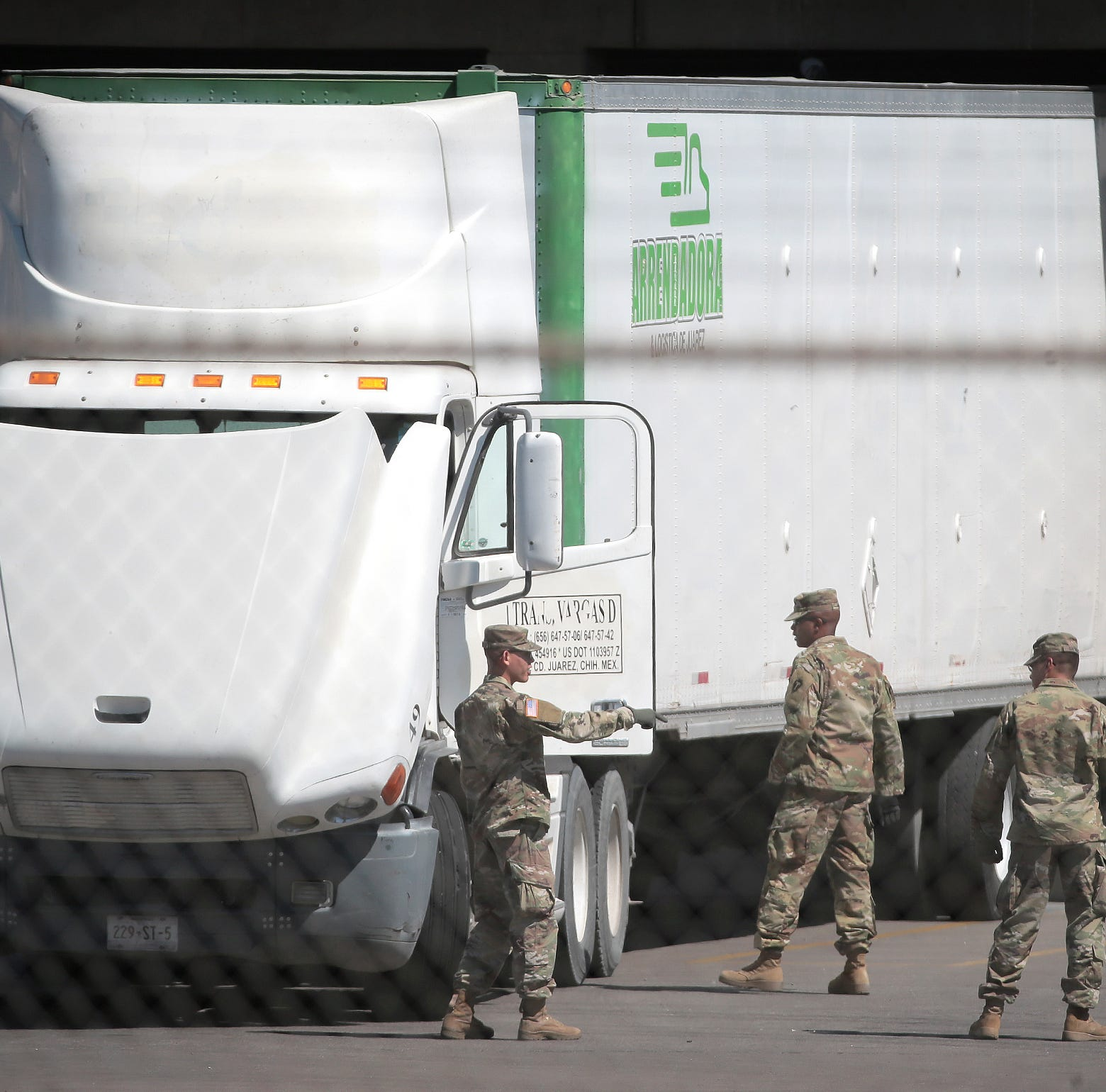 National Guard troops set up concertina wire at ports of entry in El Paso area