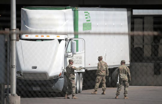 Soldiers stand by a truck at the Bridge of the Americas on April 3, 2019.