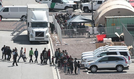 Migrants are moved through the Border Patol Facility at Hondo Pass and US54 Tuesday, April, 2, 2019. Tents are being constructed at the site. Migrants are moved through the Border Patol Facility at Hondo Pass and US54 Wednesday. Tents are being constructed at the site. The site replaces the location under the Paso del Norte International Bridge.