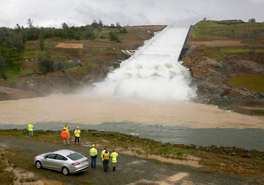 Water flows down the Oroville Dam spillway in Oroville on Tuesday. California officials opened the flood-control spillway at the nation's tallest dam for the first time since it was rebuilt after it crumbled during heavy rains two years ago.
