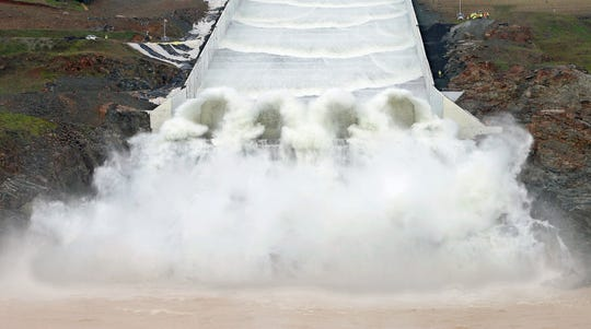 Water flows down the Oroville Dam spillway in Oroville on Tuesday for the first time since it was rebuilt after it crumbled during heavy rains two years ago.
