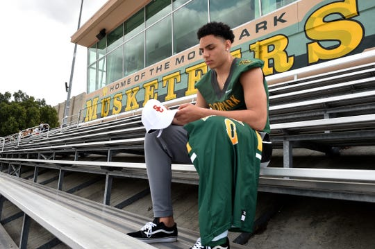 After starring in football and basketball at Moorpark High, Drake London is prepared for the rigors and time commitment of playing both at USC.