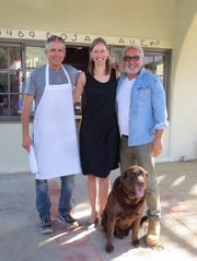 Ojai Rotie sommelier Emily Johnston poses with business owners Claud Mann, left, and Larry Nicola, and Nicola's chocolate lab Maverick.
