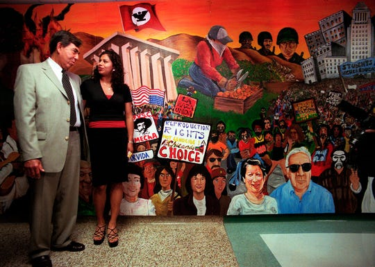 "In this May 9, 2000, file photo, Mexican opposition candidate Cuauhtemoc Cardenas, left, of the Democratic Revolution Party, poses for a photo with Candy Angel, right, president of the Mexican American student group, MEChA, during a visit to the Chicano Studies Department at CSU Northridge. MEChA, a Mexican American student group founded 50 years ago, is considering a name change, highlighting the divisions between older civil rights advocates and younger activists. Student leaders voted March 31 in Los Angeles to drop the reference to ""Chicano"" and ""Aztlan"" from the group's full name."