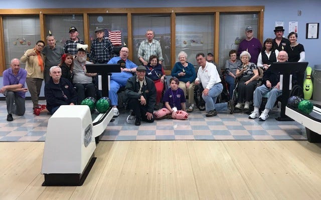 Members of the South Jersey Cruisers Association Car Club visited the New Jersey Veterans Memorial Home in Vineland to assist residents with bowling activities.