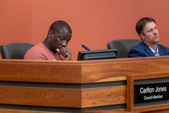 Councilmen Carlton Jones, left and Greg Nunley listen during a Tulare City Council meeting on Tuesday, April 2, 2019.