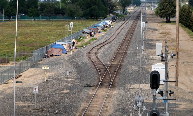 Dozens of homeless people have set up shelters along the railroad tracks west of J Street between Prosperity and Cross avenues on Wednesday, April 3, 2019.