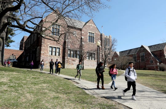 Students leave Ossining High School at the end of the school day April 3, 2019.