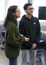 Ardsley High School twins Amber and Adeel Arif demonstrate the app they built to train users in CPR April 2, 2019.