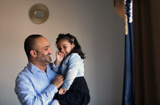 Yemeni-American Zaid Nagi, 37, jokes around with his daughter Jenna, 3, at home in Yonkers April 3, 2019. Nagi has been unable to bring his mother to the United States to join him, his wife, and their four children because of the travel ban.