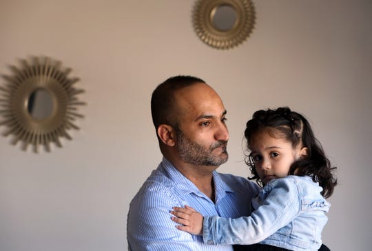 Yemeni-American Zaid Nagi, 37, holds his daughter Jenna, 3, at home in Yonkers April 3, 2019. Nagi has been unable to bring his mother to the United States to join him, his wife, and their four children because of the travel ban.