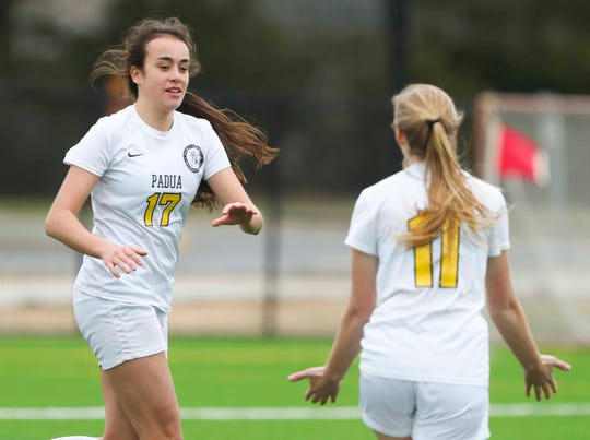Padua's Paige Kenton (left) celebrates her second goal of the game with Brandy Conte in the second half of Padua's 2-1 win at Caesar Rodney on April 2.