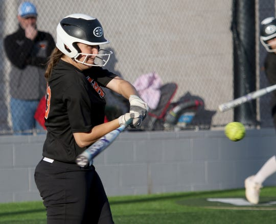 Burkburnett's Kelsea Armstrong hits a popup against Iowa Park Tuesday, April 2, 2019, in Iowa Park.
