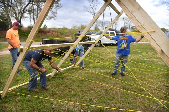 Volunteers build one of the obstacles in the children's section of T.H.O.R., Texoma's Hellacious Obstacle Run, Wednesday afternoon at Lucy Park.