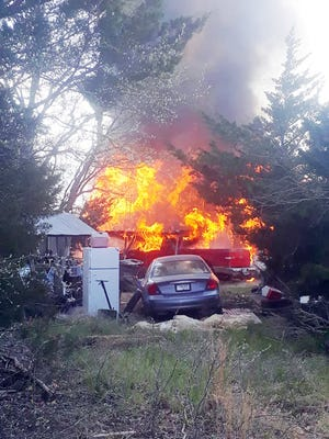 Bowie Rural Fire Department was called to a fully involved fire at 271 Maple Road in Frontier Shores about 4:10 p.m. on Monday. The heavily wooded area and narrow roads were a tight fit for fire trucks and equipment.