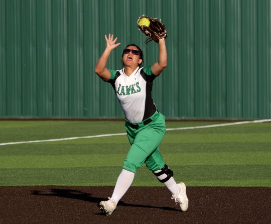 Iowa Park's Jade Martin catches the popup against Burkburnett Tuesday, April 2, 2019, in Iowa Park.