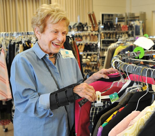 Lynn Moran sorts through donated clothing to be sold during the Faith Refuge Fashion Boutique held at First Presbyterian Church of Wichita Falls, located at 3601 Taft Blvd, April 5 and 6, from 10 a.m. to 6 p.m. Proceeds go to Faith Refuge.