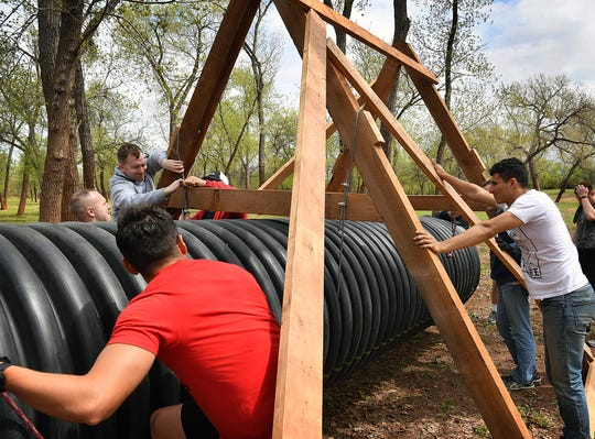 Volunteers from the 80th FTW at Sheppard Air Force Base work to build the Hamster Crawl, one of 20 obstacles in the T.H.O.R. run which will be held Saturday at Lucy Park.