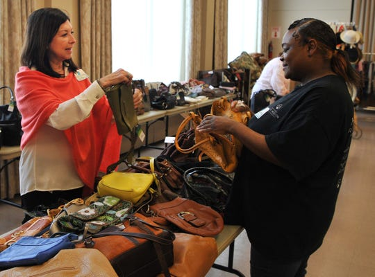 Martha Avera, left, and Latisha Gardener sort through donated purses and bags to be sold during the Faith Refuge Fashion Boutique held at First Presbyterian Church of Wichita Falls, located at 3601 Taft Blvd., April 5 and 6 from 10 a.m. to 6 p.m. Proceeds go to Faith Refuge.