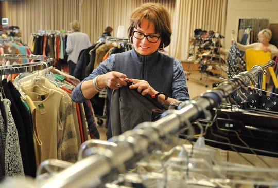 Becky Pfieffer sorts through donated clothing to be sold during the Faith Refuge Fashion Boutique held at First Presbyterian Church of Wichita Falls, located at 3601 Taft Blvd., April 5 and 6 from 10 a.m. to 6 p.m. Proceeds to to Faith Refuge.