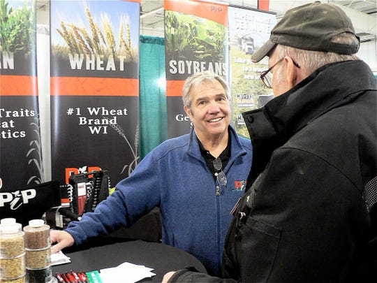 Jack Kaltenberg of Partners in Production (PiP) seeds greets a customer.