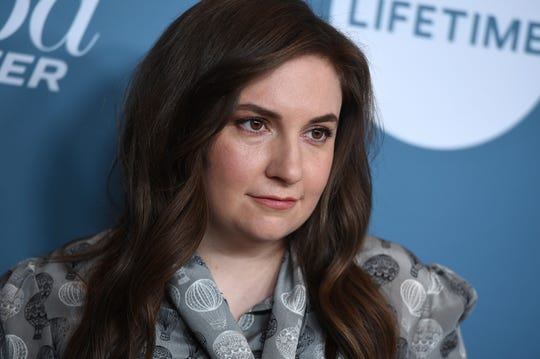 """Lena Dunham debuted her new 'Sick' tattoo Wednesday, saying on Instagram: """"Sometimes the thing you're most scared of being called is the best thing you can call yourself."""""""