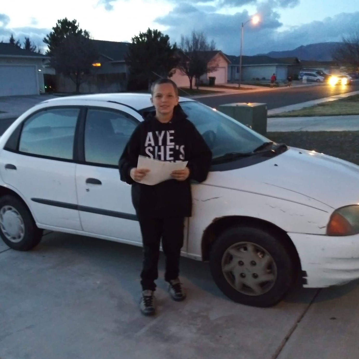 William Rabillo poses with the car that he worked to get for his mom.