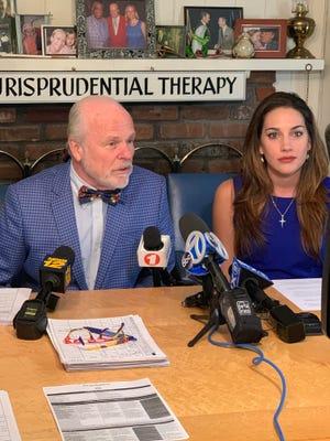 Lauren Miranda and her attorney John Ray speak to the media.