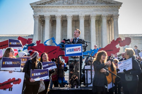 Former California Gov. Arnold Schwarzenegger speaks outside the Supreme Court in March as justices heard arguments about partisan gerrymandering, the practice of political parties crafting congressional districts that unfairly benefit one party over another.