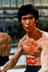 "Bruce Lee in a scene from the iconic martial-arts film ""Enter the Dragon."""