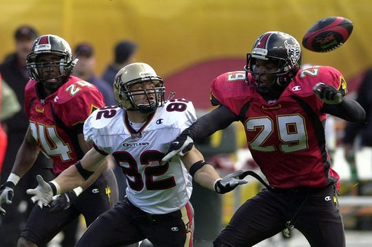 The San Francisco Demons' Terrance Joseph (29) breaks up a pass intended for Las Vegas Outlaws wide receiver Mike Furrey (82) in an XFL game in 2001.