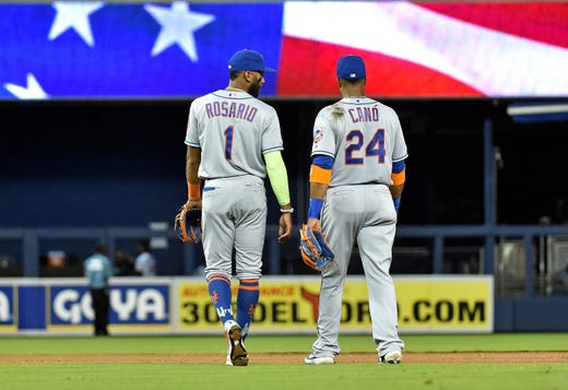 April 2: Mets shortstop Amed Rosario talks with second baseman Robinson Cano during their game against the Marlins.