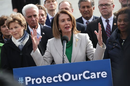 "Speaker of the House Rep. Nancy Pelosi (D-CA) speaks as other congressional Democrats listen during a news conference in front of the U.S. Supreme Court April 2, 2019  to call on the Trump administration to ""halt legal assault on Americans' health care."""