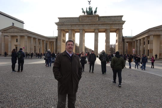 Author at the Brandenburg Gate standing on what used to be the East Berlin side of the Berlin Wall, on March 26, 2019.