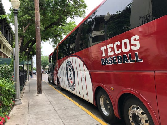 The team bus for the Tecolotes de los Dos Laredos Mexican baseball team sits outside La Posada Hotel in downtown Laredo, Texas. The team plays home games in both Laredo and Nuevo Laredo.