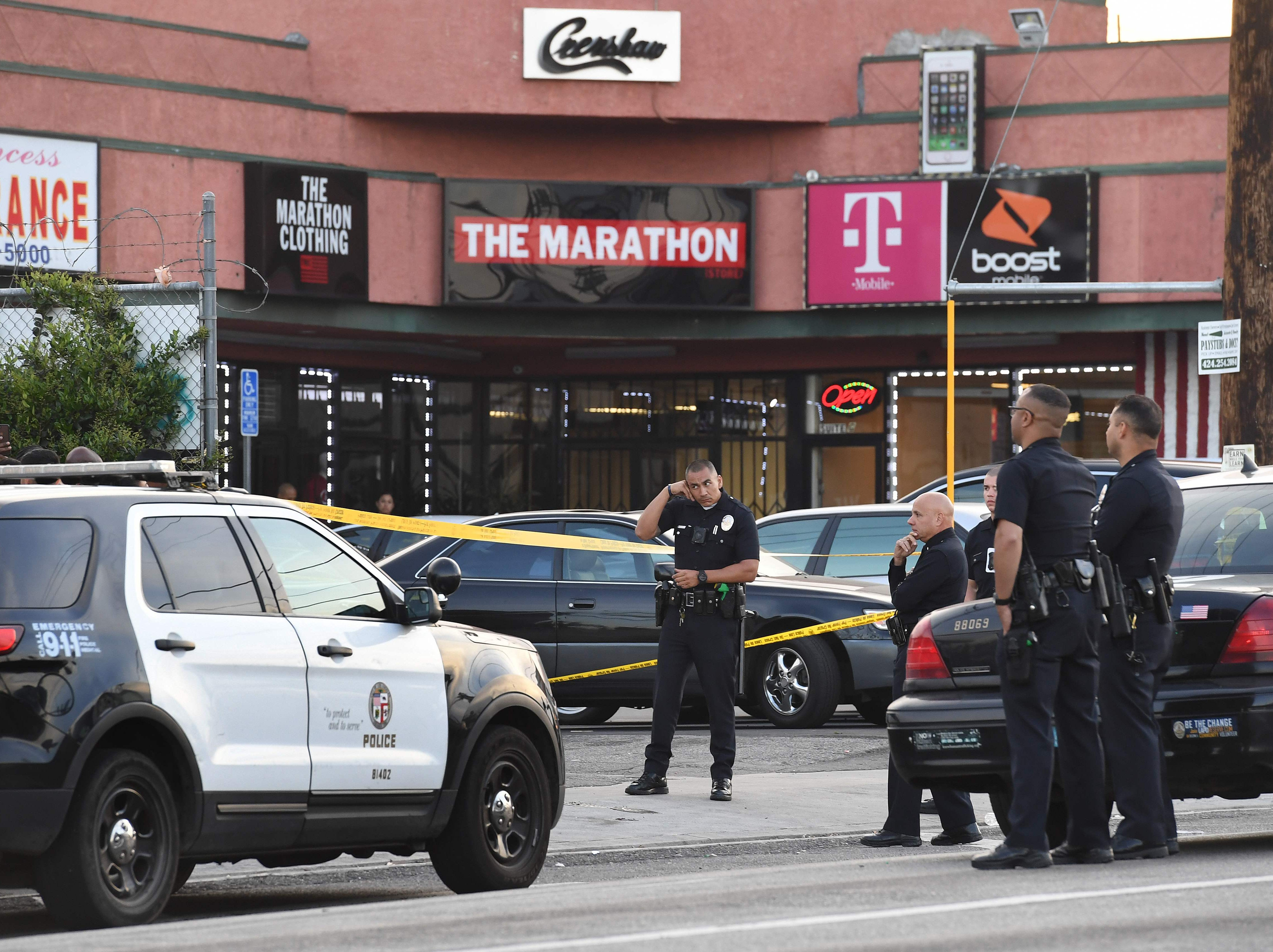 Police stand outside The Marathon clothing store owned by Grammy-nominated rapper Nipsey Hussle where he was fatally shot along with 2 other wounded, in Los Angeles on March 31, 2019.