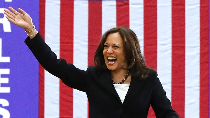 Sen. Kamala Harris, D-Calif., takes the stage for a campaign rally at Morehouse College, March 24, 2019, in Atlanta.