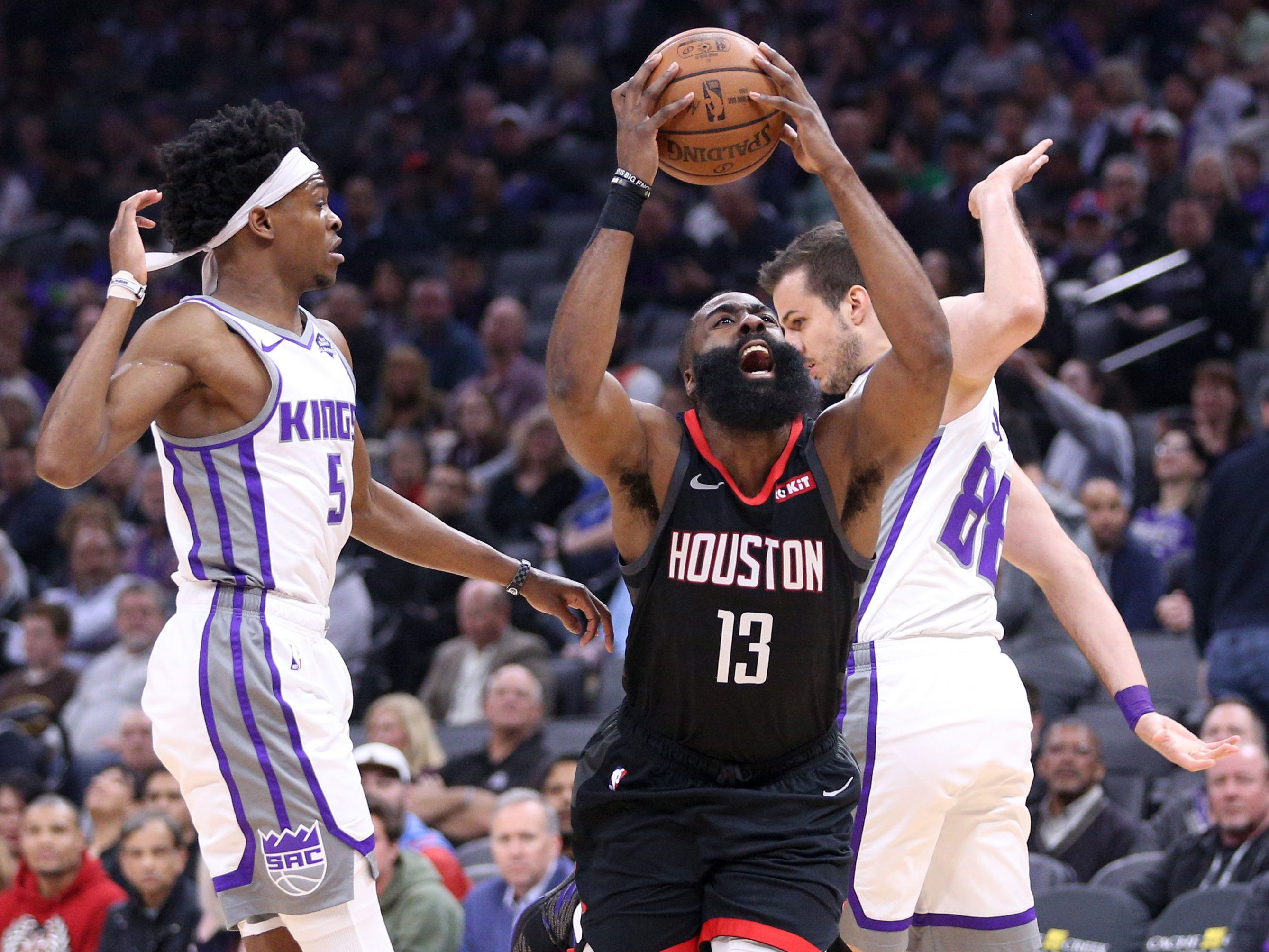 April 2: Rockets guard James Harden draws the foul while driving to the hoop against the Kings in Sacramento. Harden andtThe Rockets won 130-105.