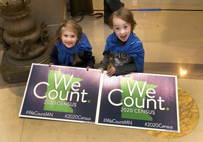 Noelle Fries, left, and Galen Biel, both 6, attend a rally at the Minnesota Capitol in 2019 to kick off a yearlong drive to ensure that all the state's residents are counted in the 2020 census. Officials say the census historically undercounts children. [ASSOCIATED PRESS ARCHIVE / 2019]