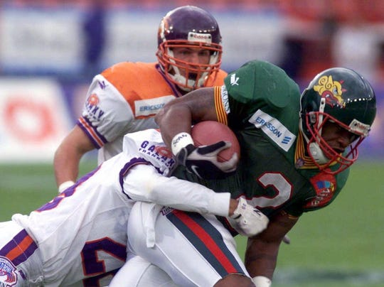 Lawrence Phillips of the Barcelona Dragons runs against the Frankfurt Galaxy in an NFL Europe game in 1999.