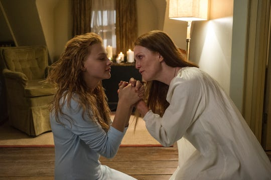 "Chloe Grace Moretz, left, is a troubled telekinetic teen and Julianne Moore is her overly religious mom in ""Carrie."""
