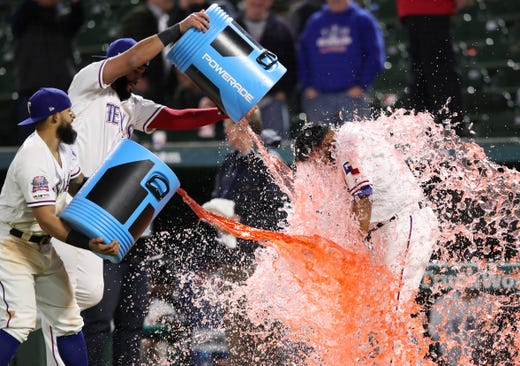 April 2: Rangers shortstop Elvis Andrus gets doused after a win against the Astros.