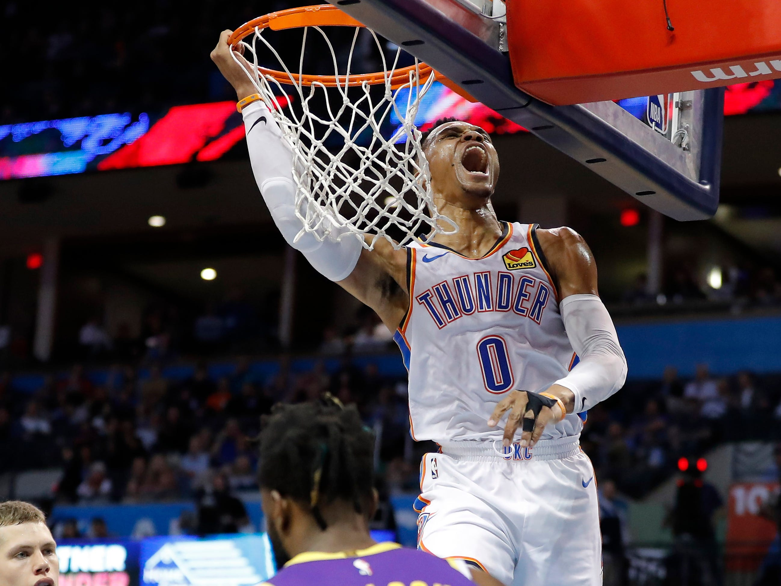 April 2: Oklahoma City Thunder guard Russell Westbrook celebrates after dunking the ball against the Los Angeles Lakers at Chesapeake Energy Arena.