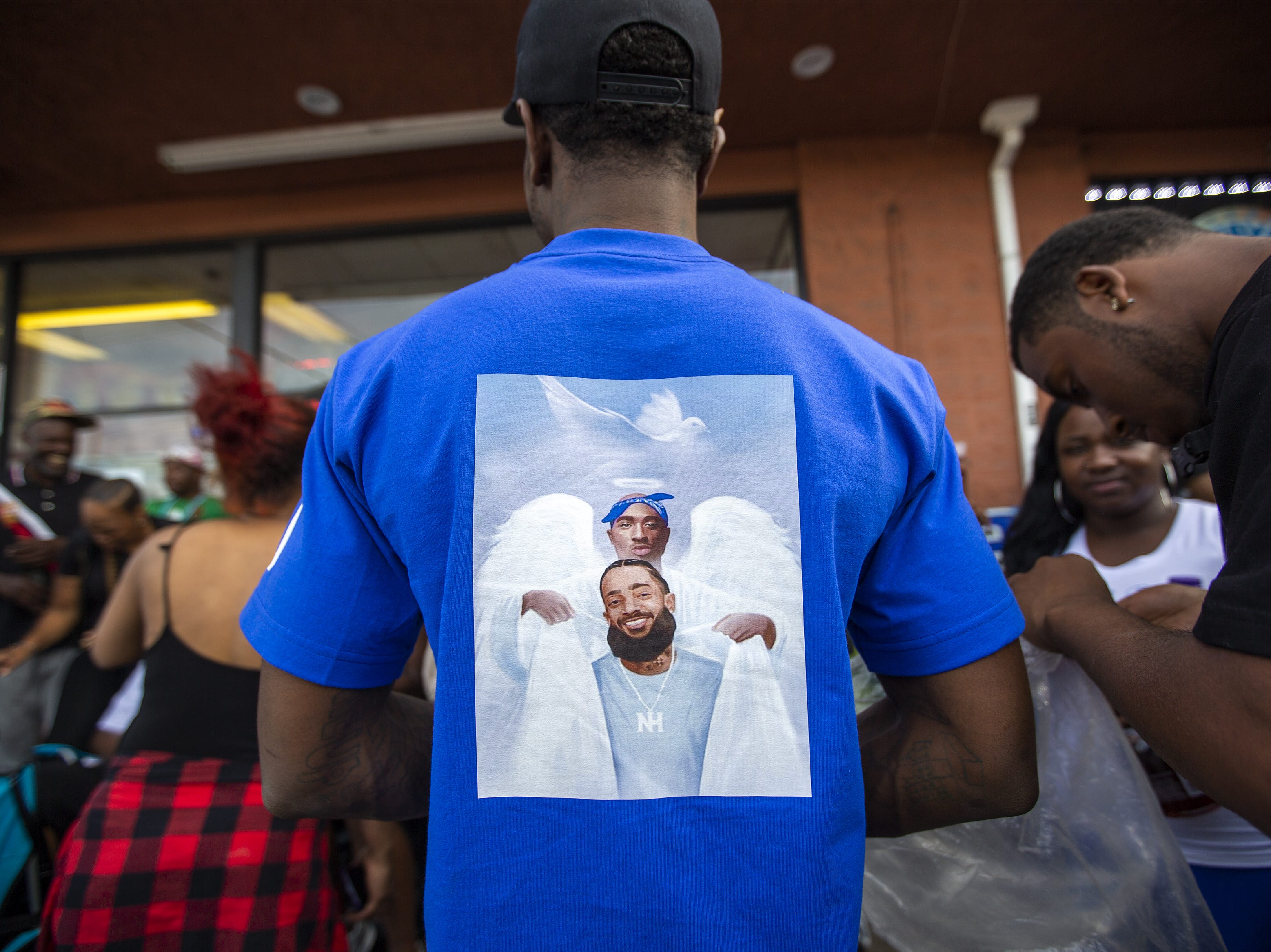 People gather to mourn for rapper Nipsey Hussle, 33, on April 1, 2019 in Los Angeles, Calif.