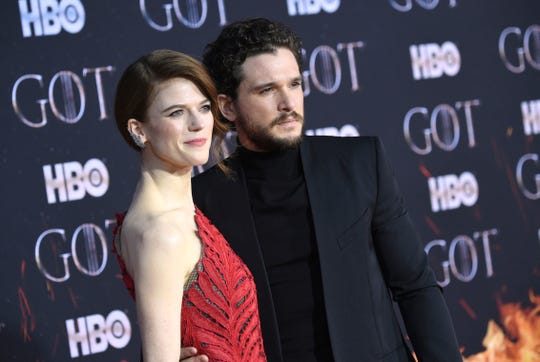 "Rose Leslie, left, and Kit Harington attend HBO's ""Game of Thrones"" final season premiere at Radio City Music Hall on Wednesday, April 3, 2019, in New York. (Photo by Evan Agostini/Invision/AP) ORG XMIT: NYPM185"