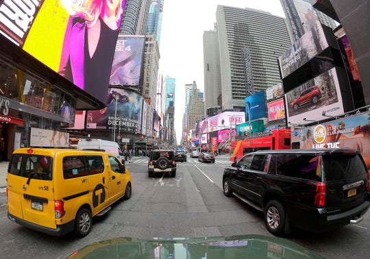 Motorists roll south on 7th Avenue in Times Square, Friday, March 29, 2019, in New York.