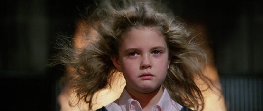"When it looks like Drew Barrymoore's going through a blow-dry routine in ""Firestarter,"" watch out."