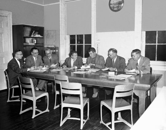 The Hillsboro City Board of Education is shown in session, April 9, 1956 as it decided not to oppose further a U.S. Court of Appeals decision which directed immediate racial integration of elementary schools. The appeals court decision reversed a previous decision of U.S. District Judge John H. Druffel, Cincinnati. The board tonight also decided to again refer the case to Judge Druffel, who is awaiting a writ of the appeals court decision.  From left to right: City Solicitor James O. Hapner, Wilfred Paul, school superintendent Paul L. Upp; Elmer Hedges, Dr. William Lukens, board president; Charles Harsha, and John H. Brown. (AP Photo/Harvey Eugene Smith)
