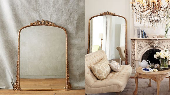 This ornate mirror brings elegance to any living space.