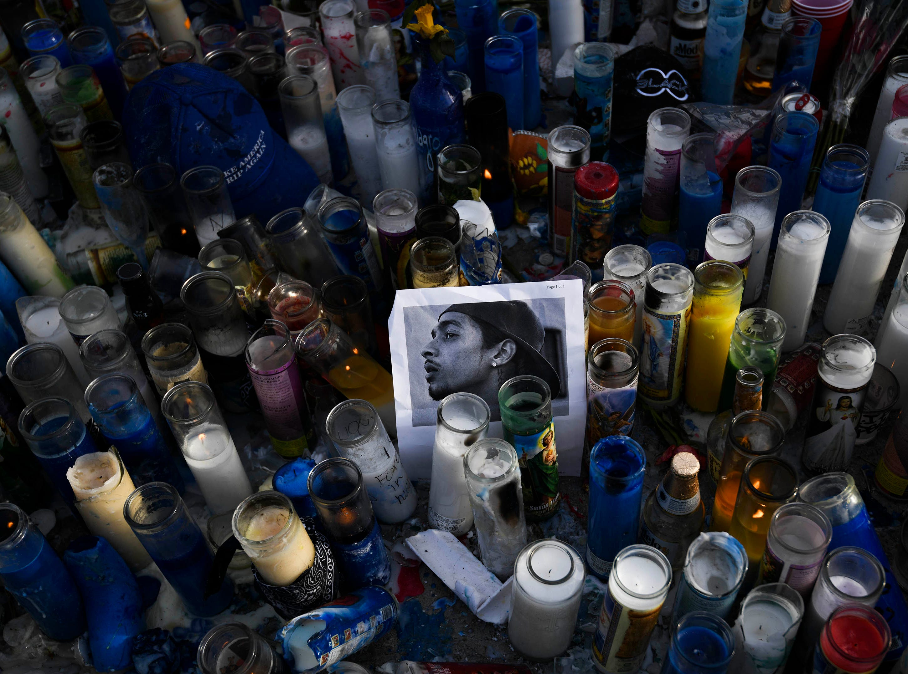 Mourners pay their respects to Nipsey Hussle near his clothing store on April 1, 2019 in Los Angeles. Hussle, a 33-year-old rapper, whose real name was Ermias Asghedom, was shot and killed outside the store on Sunday March 31, 2019.